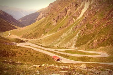 Switzerland - Umbrail Pass in Alps. Cross processing color tone.