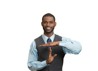 Smiling executive man giving time out gesture with hands