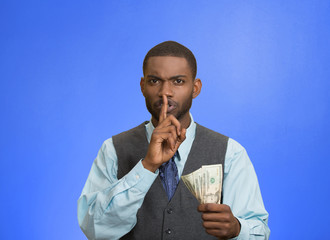 Bribery man with dollar, quiet gesture, blue background