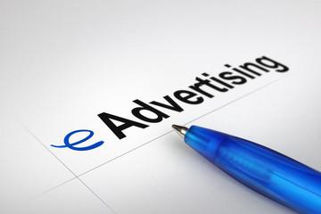 eAdvertising. Written on white paper