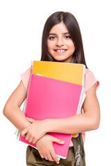 Girl holding sketchbooks