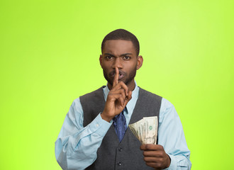 Bribery man with dollar, quiet gesture, green background