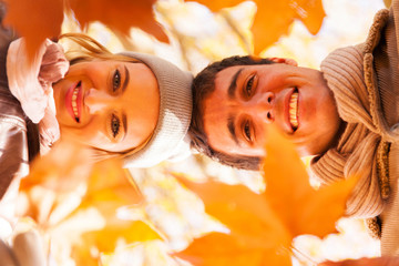 underneath view of young couple in autumn