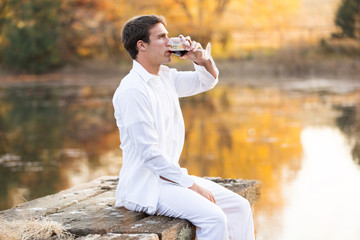 young man drinking red wine