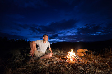 Man and campfire at night