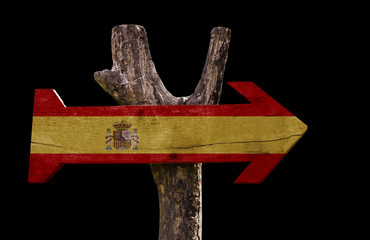 Spain wooden sign isolated on black background