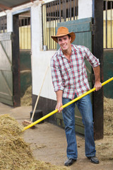 cowboy working in stable