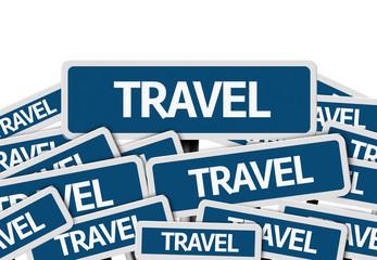 Travel written on multiple blue road sign