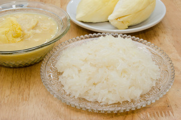 Durian and sticky rice on the wooden table