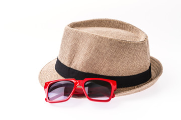 Hat , sunglasses isolated on white