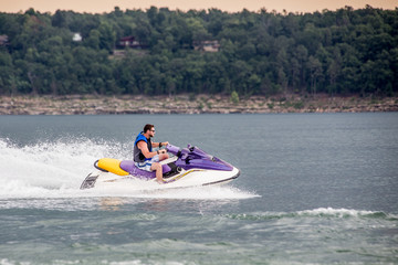 Young Man piloting a personal water craft