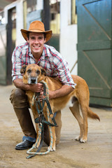 horse farm owner and his dog