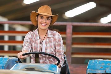 female farmer driving a tractor
