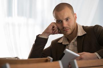 Businessman using tablet computer cafe