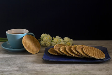 Dutch Waffles with Tea and Flowers - Selective Focus