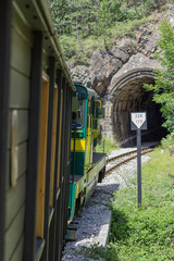 Vintage Railroad Train Enters a Dark Tunnel