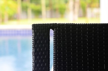 Chair along a swimming pool