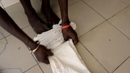 African man prepares natural fabrics
