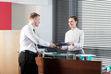 Female receptionist and businessman