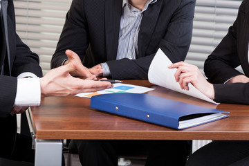 Hands of business people during meeting in office