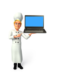 Young chef with laptop