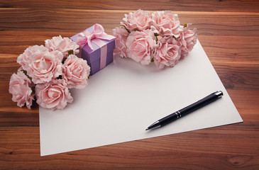 Greeting blank card with roses and gift