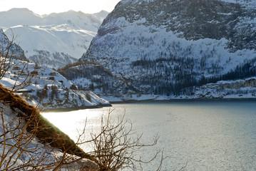 coastline of Lake Lac du Chevril in winter, France