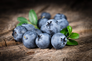 Blueberry. Organic food on a wooden table. concept for healthy e