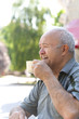 happy grandfather drinking morning coffee