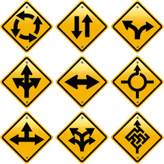 Rhombic yellow road signs with arrows directions