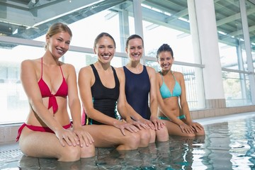 Female aqua aerobics class smiling at camera