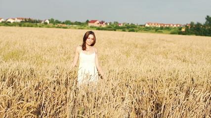 Woman walking through wheat field, super slow motion, 240fps