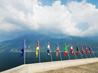 Flags of European countries over Garda lake