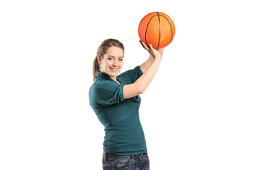 Young woman holding a basketball