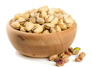 bowl of pistachio isolated on white