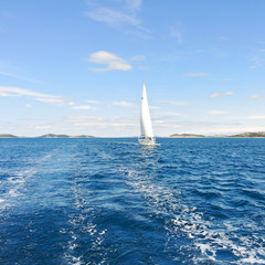 white sail yacht in blue Adriatic sea