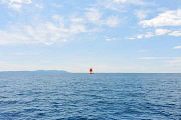 red yacht in blue Adriatic sea, Croatia