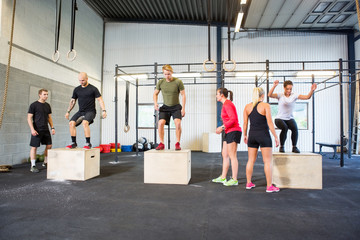 Athletes Practicing Box Jumps