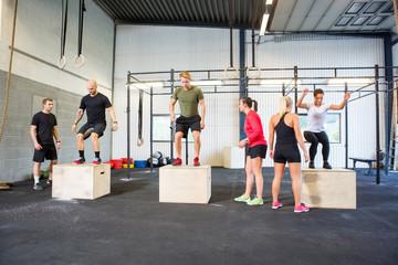 Athletes Practicing Box Jumps