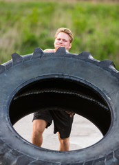 Athlete Lifting Large Tractor Tire