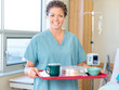 Nurse Holding Breakfast Tray In Hospital Room