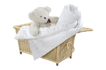 convolute blanket and teddy bear in a wicker basket