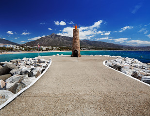 Lighthouse at the breakwater in Puerto Banus in Marbella, Spain