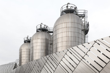 Three silos in stainless steel
