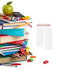 School supplies and green apple isolated on white background.