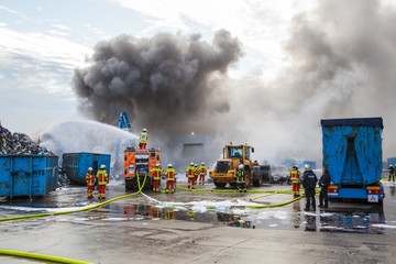 Firefighters attending to a blaze