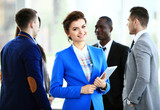 beautiful businesswoman on the background of business people