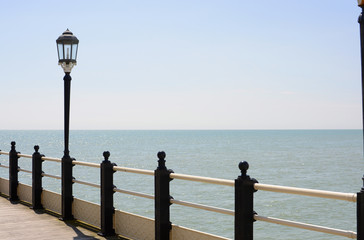 Streetlamp on pier at Worthing. Sussex. England
