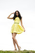 Beautiful young woman in yellow sexy dress
