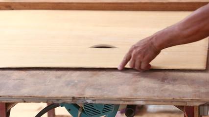 carpenter use saw cut wood for make new furniture